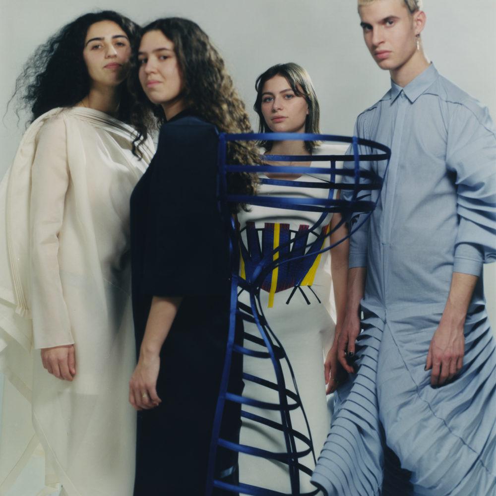 4 young people wearing beautiful patterns