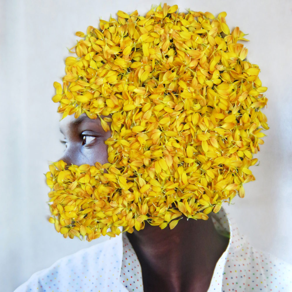Women's head covered with yellow flowers