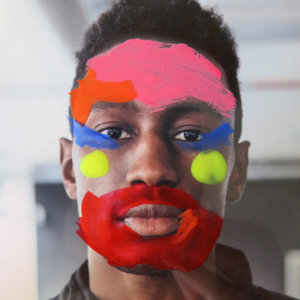 Young man with painting on his face